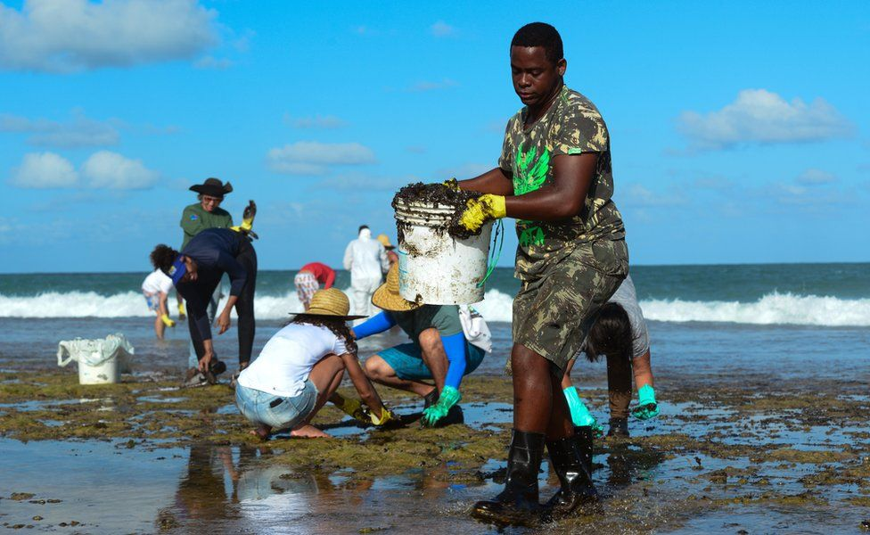 people cleaning beaches in Brazil